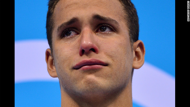 South Africa's Chad Le Clos poses on the podium after taking the gold medal in the men's 200-meter butterfly final.