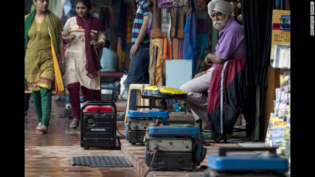 Portable generators provide electrical power to souvenir shops in Janpath Market, a popular tourist shopping area, in New Delhi on Tuesday.