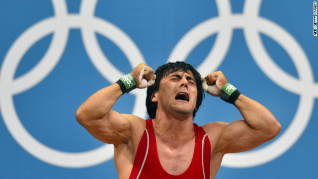 Azerbaijan's Sardar Hasanov reacts after failing a lift in the men's weightlifting 69-kilogram group B event Tuesday.