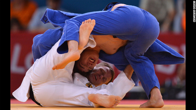Germany's Ole Bischof, in white, and Islam Bozbayev of Kazakhstan face off in the men's under 81-kilogram judo contest Tuesday.