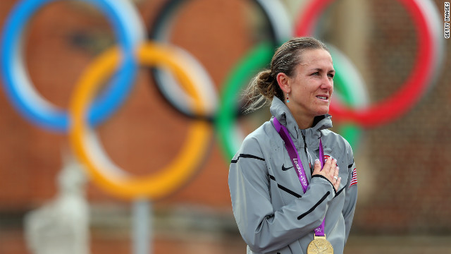 Cyclist Kristin Armstrong celebrates winning a gold medal in the Olympic cycling time trial on Wednesday. She also won the medal at the 2008 Beijing Olympics.