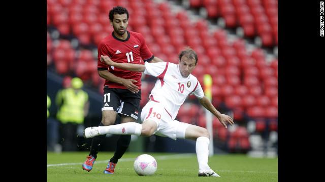 Egypt's Mohamed Salah, left, vies with Belarus' Renan Bardini Bressan during a men's soccer match.