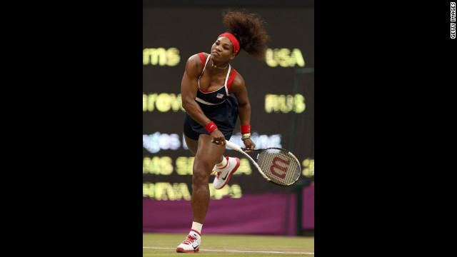 Serena Williams of the United States serves to Vera Zvonareva of Russia during the third round of women's singles tennis.
