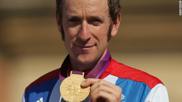Gold medallist Bradley Wiggins celebrates during the victory ceremony after the men's individual Time Trial Road Cycling.