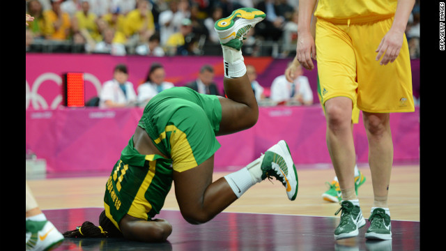 Brazilian center Clarissa Santos falls during the women's preliminary basketball match against Australia.