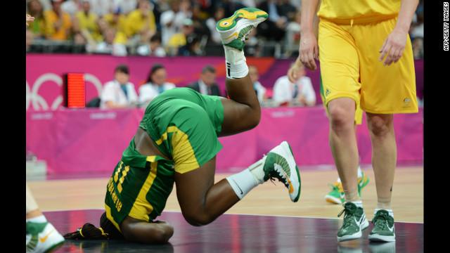 Brazilian center Clarissa Santos falls during the women's preliminary basketball match against Australia.