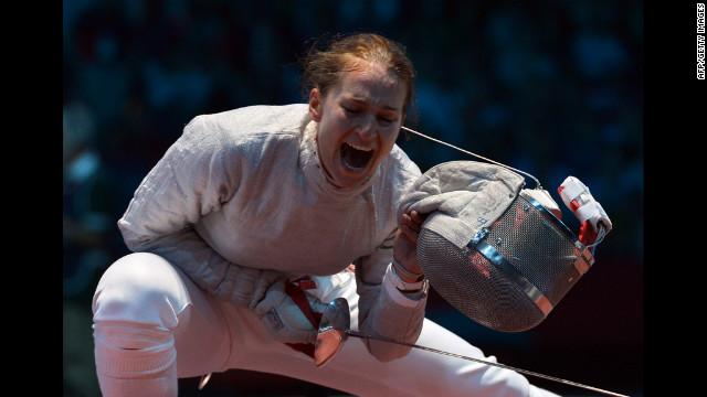 Russia's Sofya Velikaya celebrates her victory over U.S. fencer Dagmara Wozniak during their women's saber quarterfinal bout.