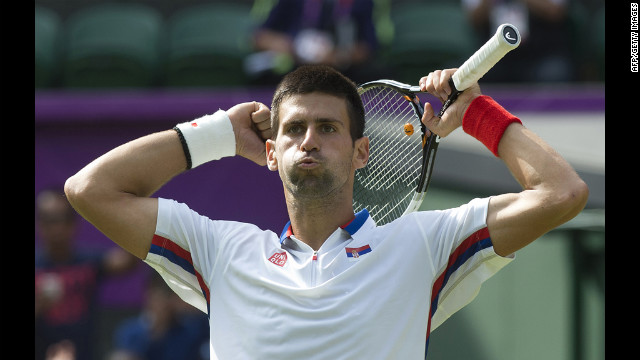 Serbia's Novak Djokovic celebrates after defeating Australia's Lleyton Hewitt in the third round men's singles tennis match.