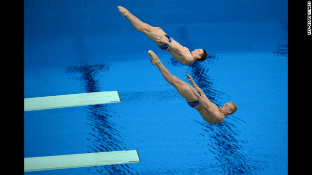 Russia's Ilya Zakharov and Evgeny Kuznetsov compete in the men's synchronized 3-meter springboard diving event.