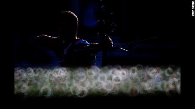Gael Prevost of France competes in the men's individual archery 1/16 eliminations match against countryman Thomas Faucheron.