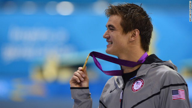 U.S. gold medalist Nathan Adrian poses on the podium after the men's 100-meter freestyle swimming event on Wednesday.