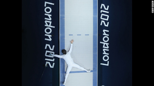 Jinsun Jung of South Korea celebrates his victory in the men's epee individual fencing bronze medal match against Seth Kelsey of the United States.