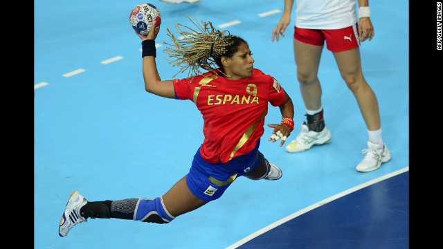Spain's rightback Marta Mangue Gonzalez jumps to shoot during the women's preliminaries Group A handball match against Denmark.