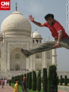 Thomas convinced someone to take a picture of him doing a flying kick in front of the Taj Mahal in India.