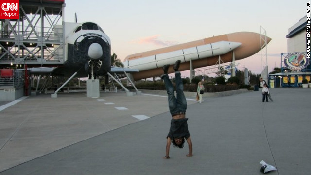 Thomas Thomas Jr.'s travel shots are full of energy and enthusiasm. Here he does one of his classic handstands at <a href='http://www.kennedyspacecenter.com/' target='_blank'>NASA's Kennedy Space Center</a> in Florida.