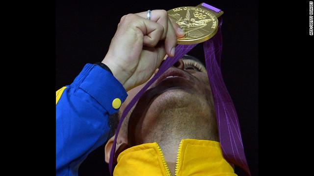 Venezuelan fencer Ruben Limardo celebrates winning the gold for men's epee.