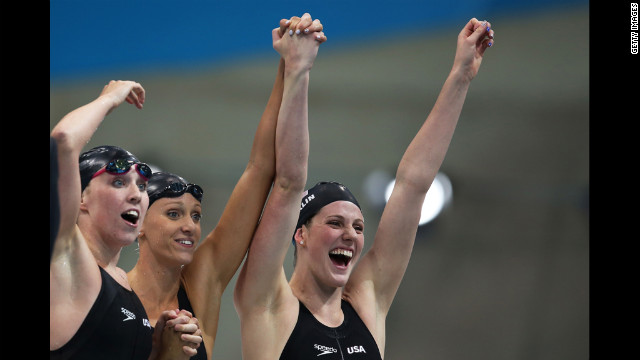 Left to right: Shannon Vreeland, Dana Vollmer and Missy Franklin celebrate after the U.S. team won gold in the women's 4x200-meter freestyle relay.
