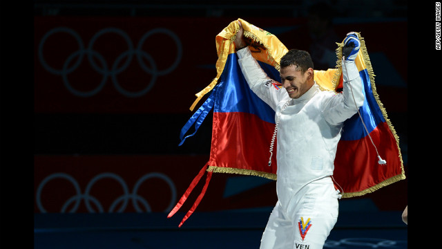 Venezuelan fencer Ruben Limardo celebrates his victory over Norway's Bartosz Piasecki at the end of their gold medal match in men's epee.