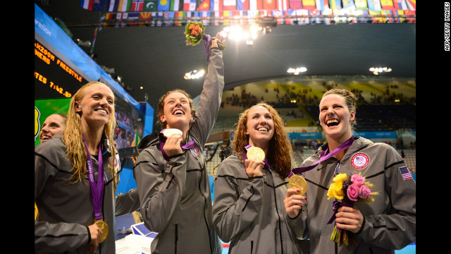 U.S. gold medalists, from left, Dana Vollmer, Allison Schmitt, Shannon Vreeland and Missy Franklin celebrate on the podium after winning the women's 4x200-meter freestyle relay on Wednesday.