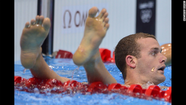U.S. swimmer Tyler Clary awaits assistance to reassemble his limbs.