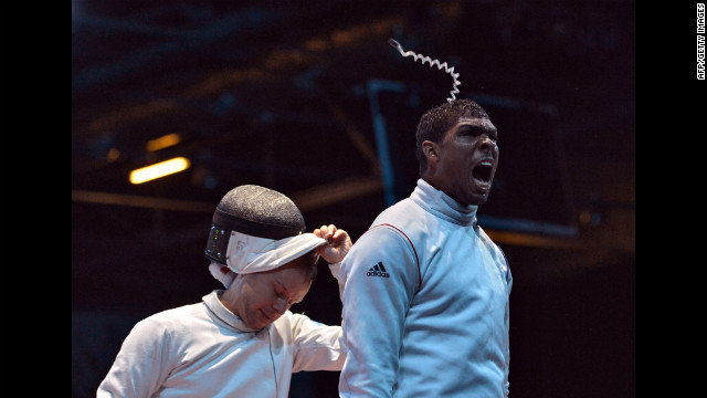 Ukraine's Dmitriy Karuchenko, left, reacts to losing the finals of Pin the Tail on the Donkey.