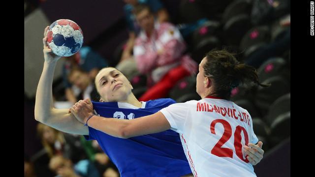 Russia's left back Victoria Zhilinskayte, left, vies with Croatia's pivot Vesna Milanovic-Litre during the women's preliminaries group B handball match.