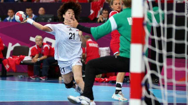 Hyobi Jo of Korea takes a shot at goal against Norway in the women's preliminaries group B handball match Wednesday. Check out photos of day six of the competition from Thursday, August 2.