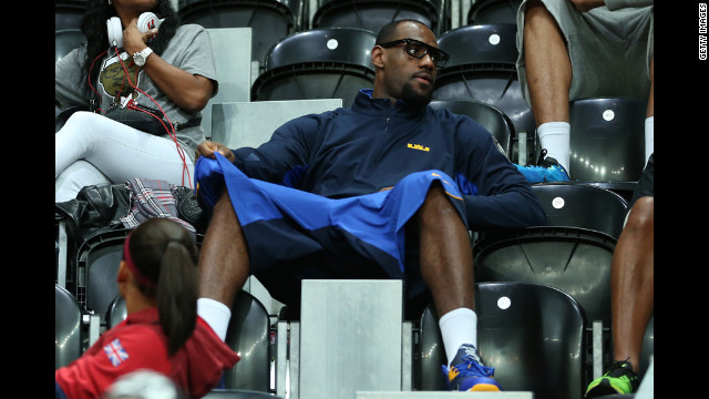 United States men's basketball player LeBron James watches the women's basketball preliminary round match between the United States and Turkey.