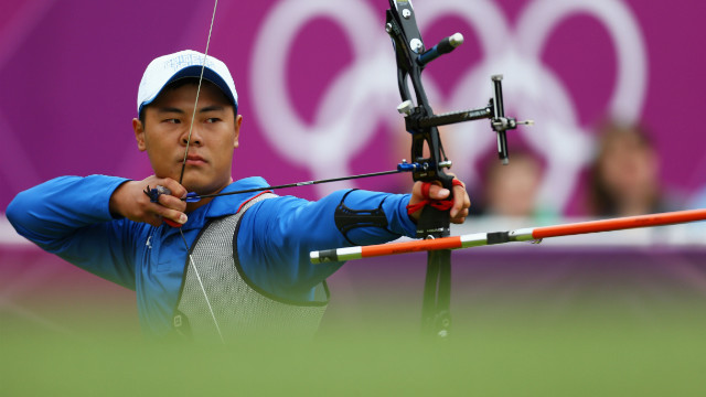 Chen Yu-Cheng of Chinese Taipai competes Wednesday in the men's individual archery 1/16 eliminations match against Viktor Ruban of Ukraine. Check out photos from Day 6 of the competition.