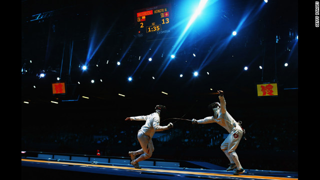 Paris A. Inostroza Budinich of Chile competes against Max Heinzer of Switzerland in the men's individual epee fencing round of 32 on Wednesday.