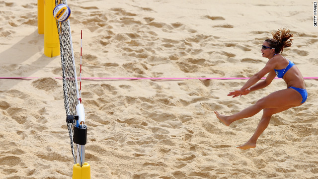 Vasiliki Arvaniti of Greece hits the ball over the net during the women's beach volleyball match between China and Greece on Wednesday.