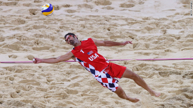 Todd Rogers of United States dives for a shot during the men's beach volleyball preliminary match against Spain.