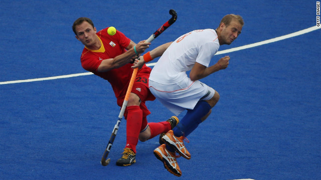 Alexandre de Saedeleer of Belgium hits past Billy Bakker of the Netherlands during their field hockey match at Riverbank Arena in London on Wednesday.
