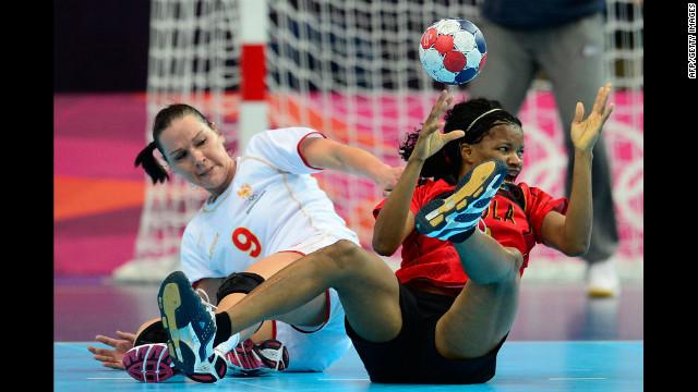 Montenegro's center back Ana Radovic, left, vies with Angola's Natalia Bernardo during the women's preliminary handball match Wednesday.