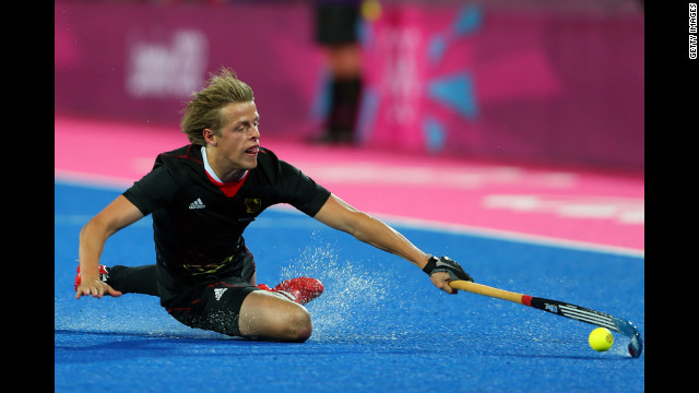 Germany's Benjamin Wess attempts to maintain control of the ball during the men's hockey match against South Korea.