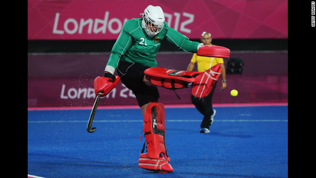 Germany's goalkeeper Max Weinhold clears the ball during the men's preliminary hockey match against South Korea.