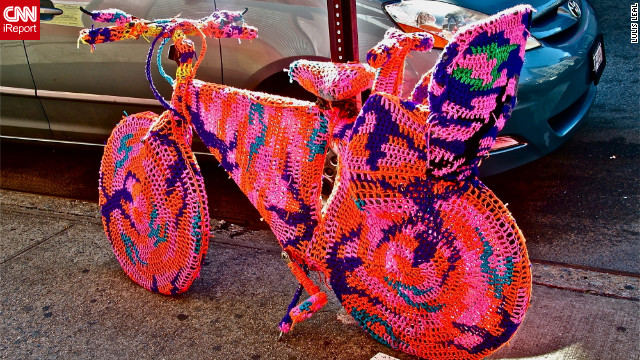 The <a href='http://ireport.cnn.com/docs/DOC-795381'>crocheted bicycle</a> was a part of an art installation by a Polish artist name Agata Oleksiak, according to iReporter Lulis Leal. She captured this photograph in New York, New York.