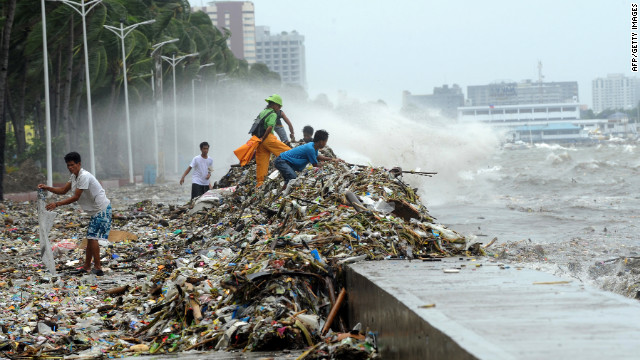 Locals pick through debris from the typhoon along Manila's Roxas Boulevard. 