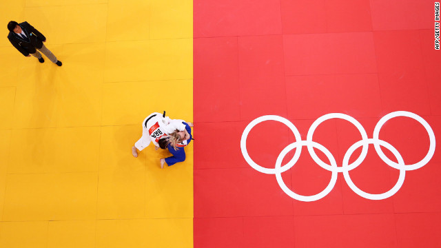 Brazil's Mayra Aguiar, in white, and Daria Pogorzelec of Poland compete in the women's under 78-kilogram judo event.