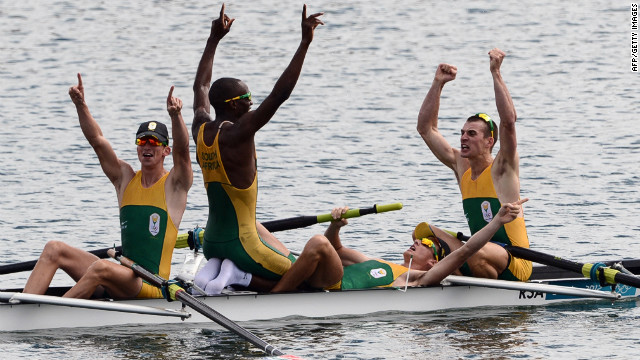 South African rowers celebrate after winning the gold medal in the men's lightweight four final A rowing event.