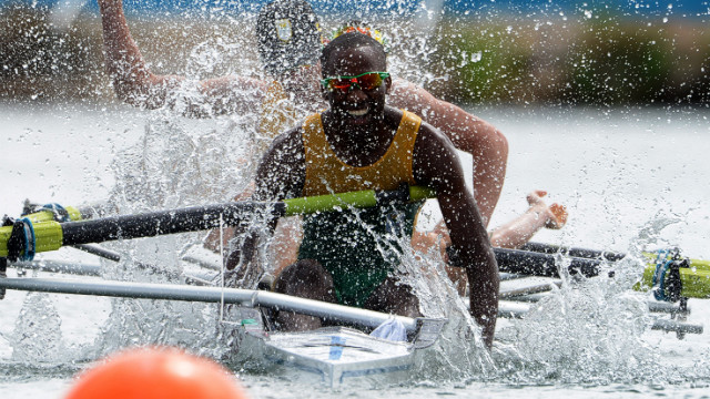 Sizwe Ndlovu of South Africa celebrates after he and his team won the gold in the lightweight men's four final rowing event.