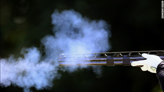Hungary's Richard Bognar fires his rifle in the men's double trap qualification round at the Royal Artillery Barracks in London.