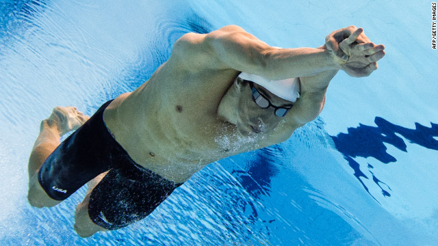 Michael Phelps of the United States competes in the men's 100-meter butterfly heat.