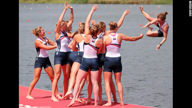 The U.S. rowing team throw Mary Whipple into the water as they celebrate winning gold in the women's eight rowing event.