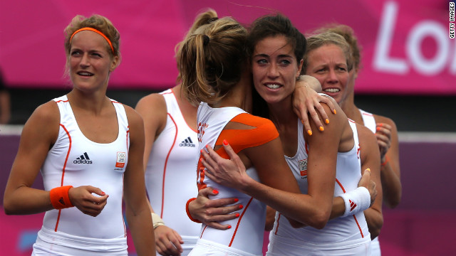 Naomi van As of the Netherlands hugs teammate Eva de Goede after their team defeated China in a women's field hockey preliminary match.