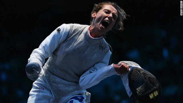 Italy's Valentina Vezzali is exuberant after beating France's Astrid Guyart in the women's foil team fencing semifinal.