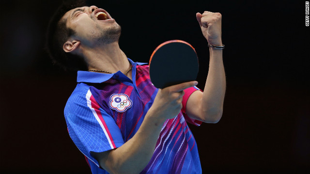 Chih-Yuan Chuang of Taiwan celebrates a point during the men's singles table-tennis bronze medal match against Germany's Dimitrij Ovtcharov.