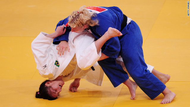 Mayra Aguiar of Brazil, in white, and Kayla Harrison of the United States compete in the women's under 78-kilogram judo event.