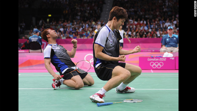Yong Dae Lee, right, and Jae Sung Chung of South Korea celebrate their win over Indonesian opponents in the men's doubles badminton quarterfinal.