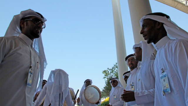 "Qatari musicians drum up visitors to the country's pavilion. ""It's about people, not business,"" says its manager Mona Sulaiti."